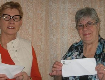 Pink charity day cheque handover